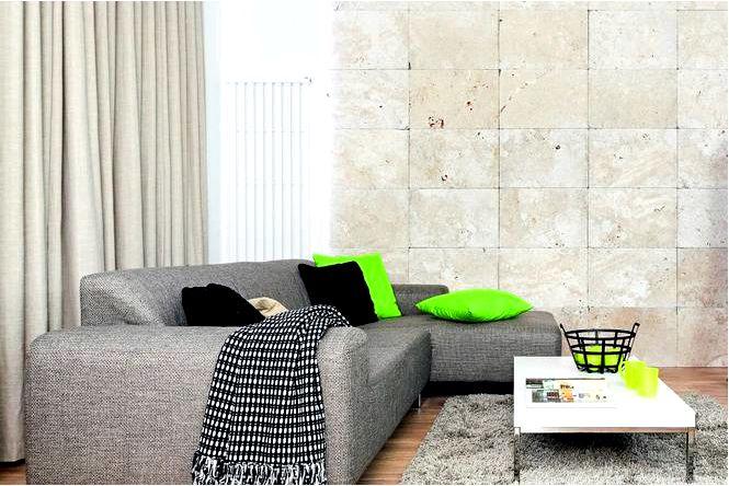 Обустройство гостиной камнем на стене