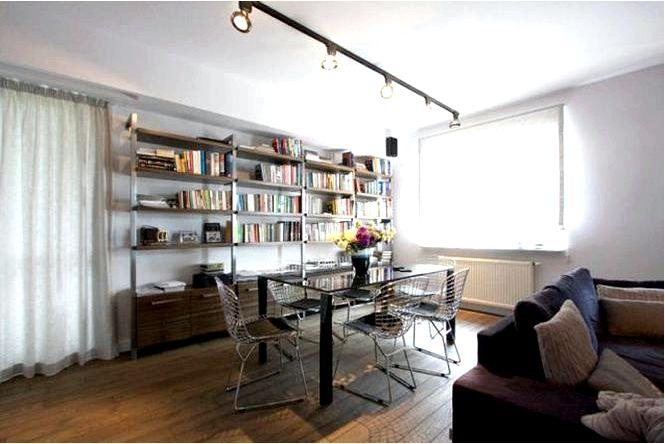 Дизайн интерьера в стиле лофт, т.е. полированный бетон и белый кирпич в интерьере