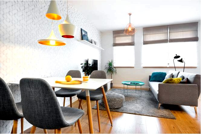 Бело-серая квартира для семьи в современном скандинавском стиле